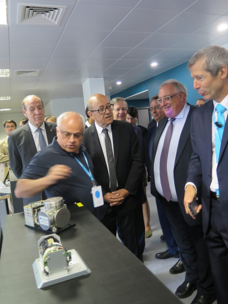 Jean-Yves Le Drian is being shown different types of inertial platforms produced by iXblue. Next to him, Hervé Guillou, CEO of DCNS — one of iXblue's best customer — and Philippe Debaillon-Vesque, iXblue President and CEO. © J. Roukoz