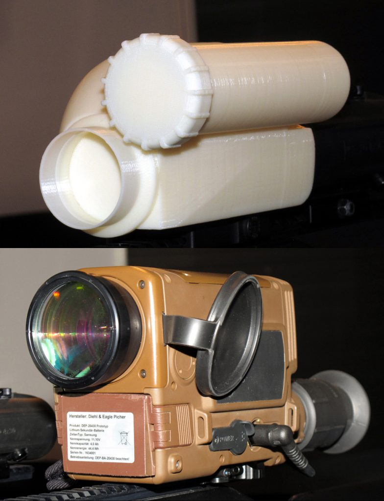 Bottom, the current aspect of AIM Infrarot-Module short wave infrared sight, on top the final case that will host the system, and which will be available in 2017. © P. Valpolini