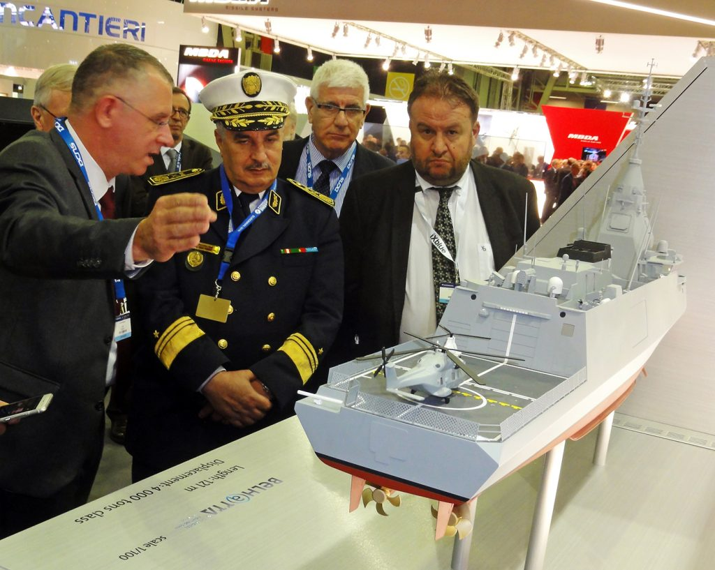 Admiral Mohammed Larbi Haouli, the Algerian National Navy chief of staff is being given explanations about the novel French 4,000-ton Belharra light frigate on the DCNS exhibition stand. © J.-M. Guhl