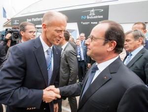 French President François Hollande (right) is welcomed by Airbus Group CEO Tom Enders (left) at the company's static display.