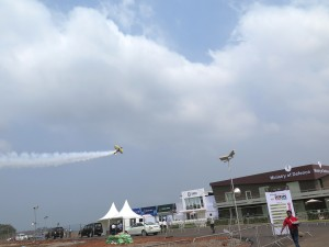 Acrobatic air demonstration during the opening of DEFEXPO
