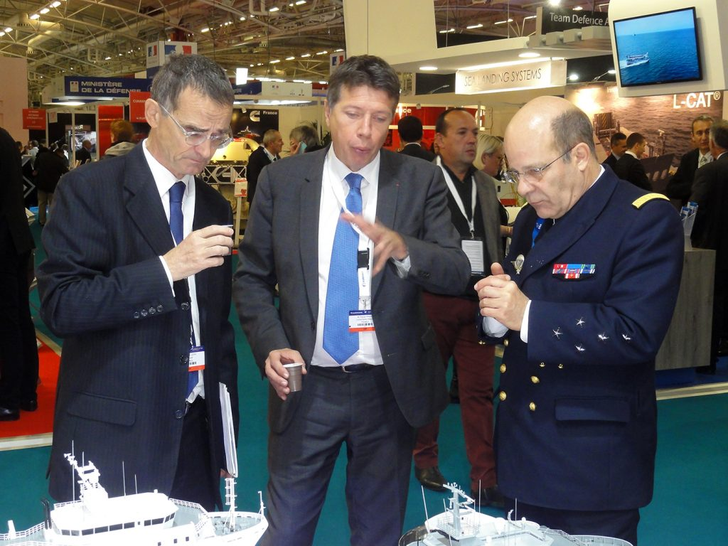 Admiral Christophe Prazuck, the French Navy chief of staff (at right) in discussion with Pascal Piriou (centre), head of the Piriou shipyard in Concarneau, Brittany.  © J.-M. Guhl